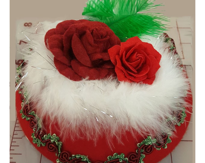 Red Beret wool hat headband with Red and Green trim, white boa Felt roses, and accented with feathers.