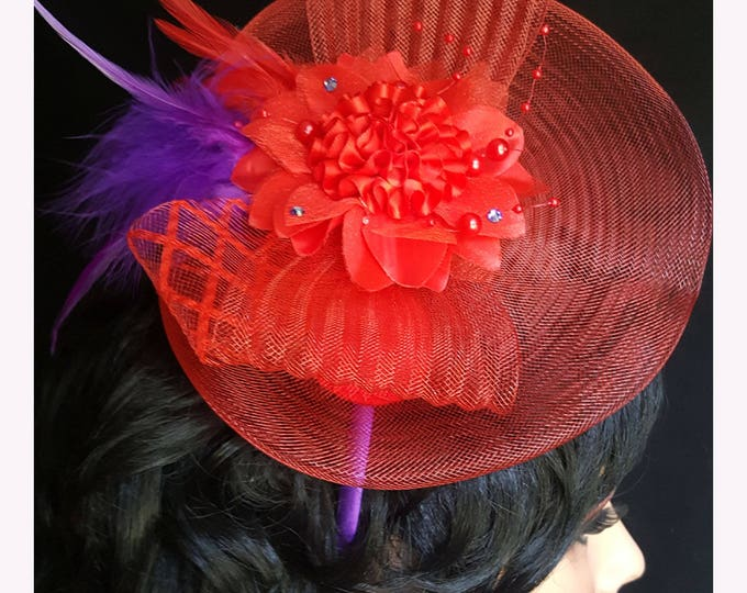Red Hat Society Bow-tique Fascinator with Red Net Base, Red Net Bow, Silk and satin flowers, Feathers, and Rhinestones.