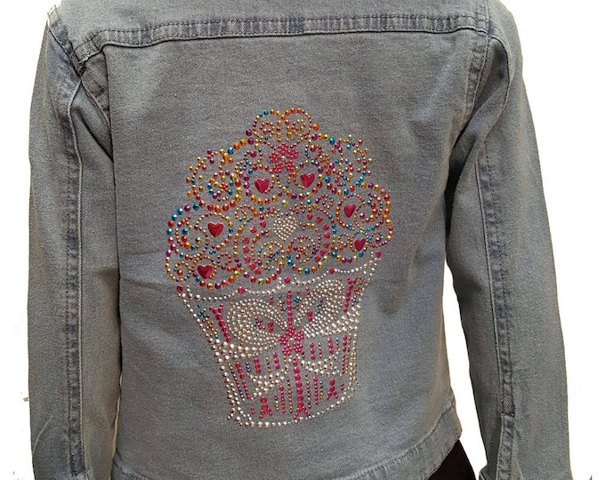 Kid's Metal Bling Cupcake denim kid's jacket with long sleeves, pockets, and colorful metal bling cupcake embellishment. Lead Free.