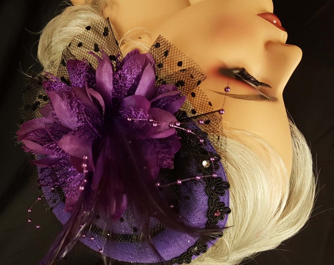 Sassy Purple fascinator hat with narrow black fur trim,  black gimp edging, flower with beaded feathers, glass crystals and dotted netting.