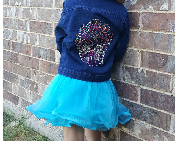 Kid's Metal Bling Cupcake dark denim kid's jacket with long sleeves, pockets, and colorful metal bling cupcake embellishment. Lead Free.