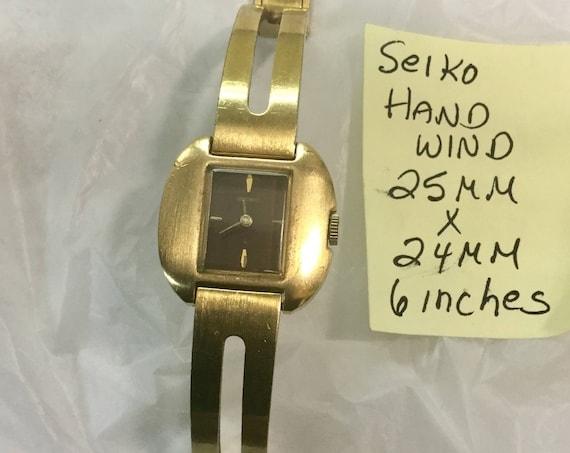 1960s Ladys Hand Wind Seiko Gold Plate Wristwatch 25mm by 24mm 6 inches