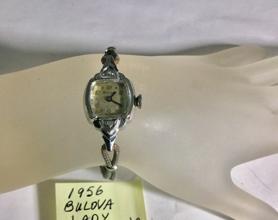 1956 Bulova Ladys Hand Wind Wristwatch with Cord Band 17mm by 32mm 6 1/2 inches