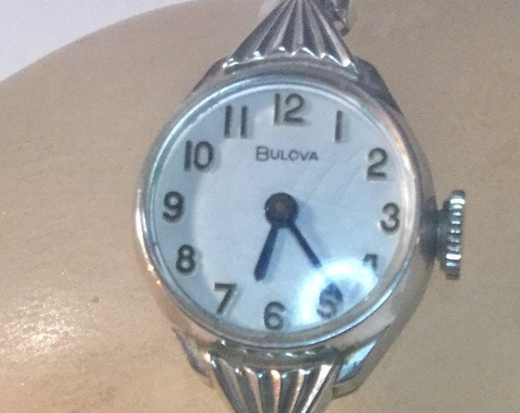 1973 Bulova Ladys Hand Wind White Gold Filled Watch and Band 16mm by 26mm