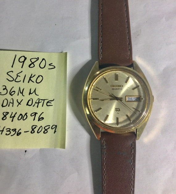 1980s Seiko Mans Day Date Quartz Gold Plate Top Stainless Screwback 36mm