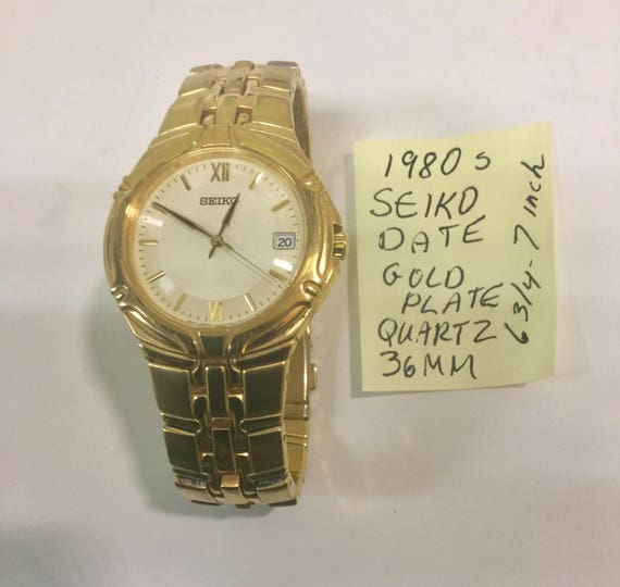 1980s Seiko Date Gold Plate Wristwatch Quartz 36mm 7 inches  unworn condition