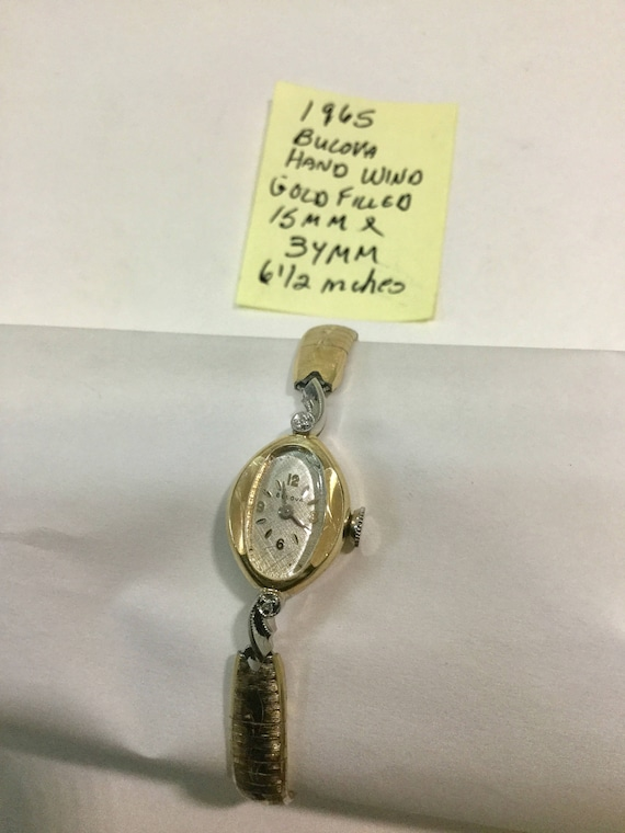 1965 Bulova Ladys Hand Wind Gold Filled Wristwatch 15mm by 34mm 6 1/2 inches