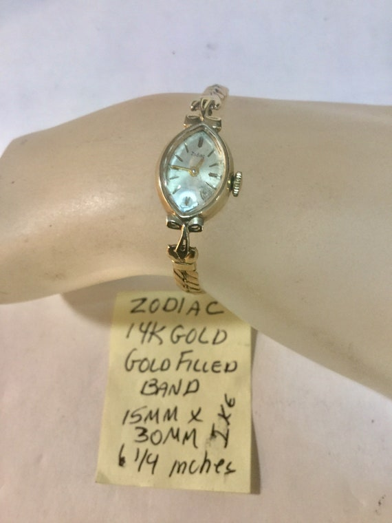 1960s Ladys Zodiac 14k Gold with Gold Filled Band Runs 15mm x 30mm 6 1/4""