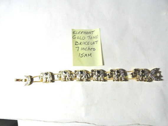 1980s Gold Tone Elephant Herd Bracelet Floating Elephants 7 inches long 15mm