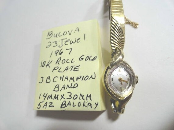 1967 Bulova Ladys 23 Jewel Wrist Watch For Parts or Repair with Champion Band 14mm by 30mm