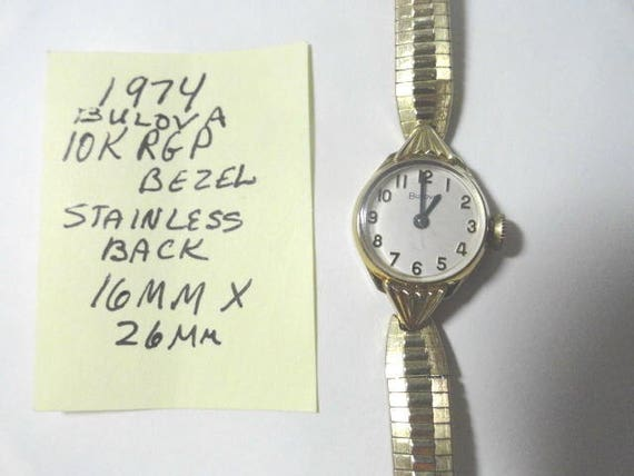 1974 Bulova Lady's Gold Filled Hand Wind Wrist Watch 16mm by 26mm with Gold Filled Band