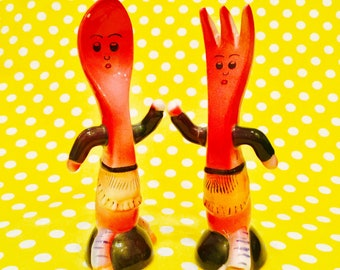 Anthropomorphic Dancing Spoon Couple wearing Grass Hula Skirts Salt and Pepper Shakers made in Japan circa 1950s