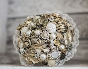 Gold brooch and button brides bouquet