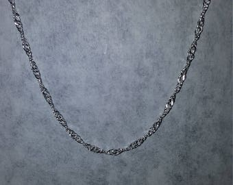 Silver twisted necklace.