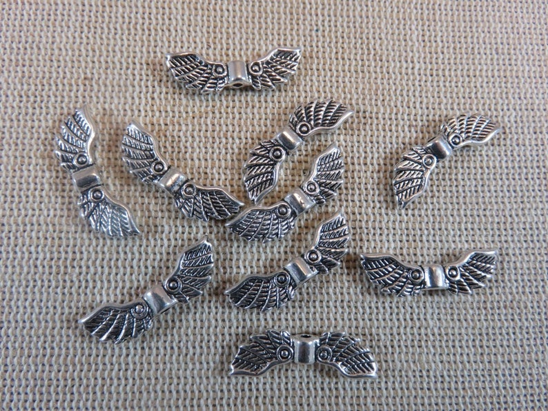 10 Silver-colored metal angel wing beads 22mm  set of 10 image 0
