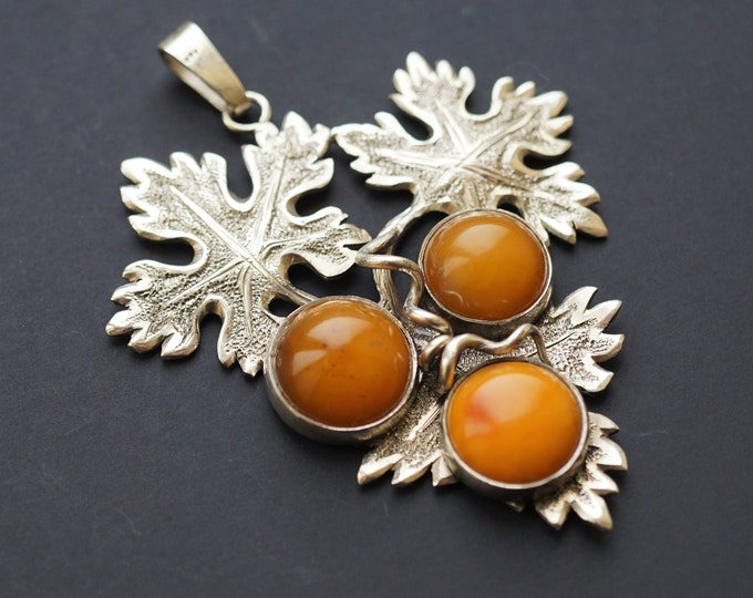 21g Handmade Sterling Silver Baltic Amber Pendant, Sculptured, it is not a cast.