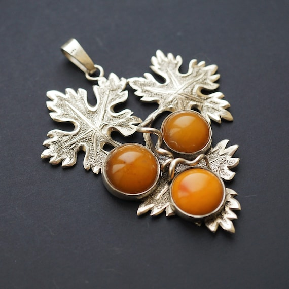 21g Hand Carved Sterling Silver Baltic Amber Pendant, Sculptured, it is not a cast.