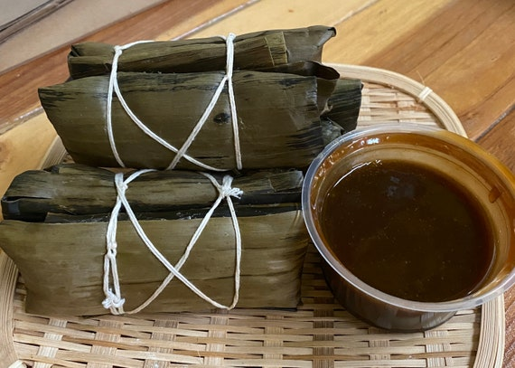 Suman sa Lihiya 4 pairs (Rice Cake wrapped in banana leaves) with coconut milk brown sugar syrup