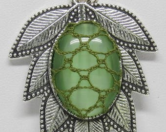 Bobbin Lace Leaf Pendant: Green Cabochon with Filigree Lace Overlay