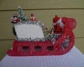 Vintage Santa Claus in a Vintage Sleigh