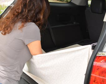 Baby diaper changing pad. Provides privacy during diaper changing in cargo area.