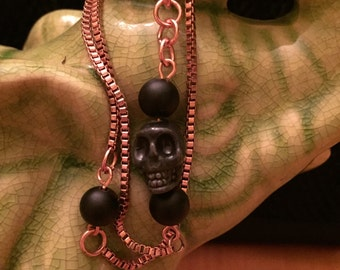 Rose gold - copper chain bracelet with black skull. Elegant beauty, double wrapped around your wrist.