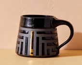 House of Harlow 1960 Creator Collab - Black on Black Striped Mug with Gold Luster, Geometric Ceramic Mug, Black and Gold Coffee Cup