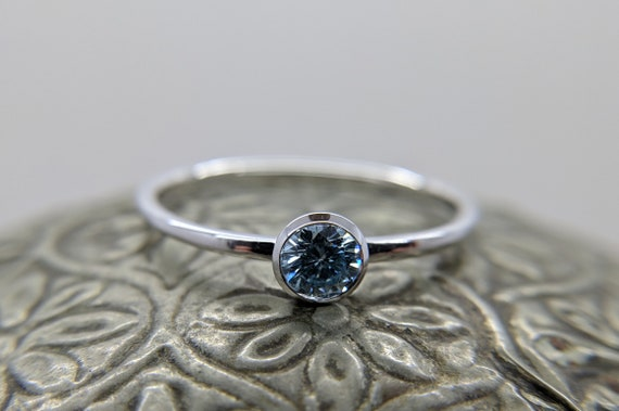 Blue Moissanite Round Brilliant Bezel Solitaire Ring
