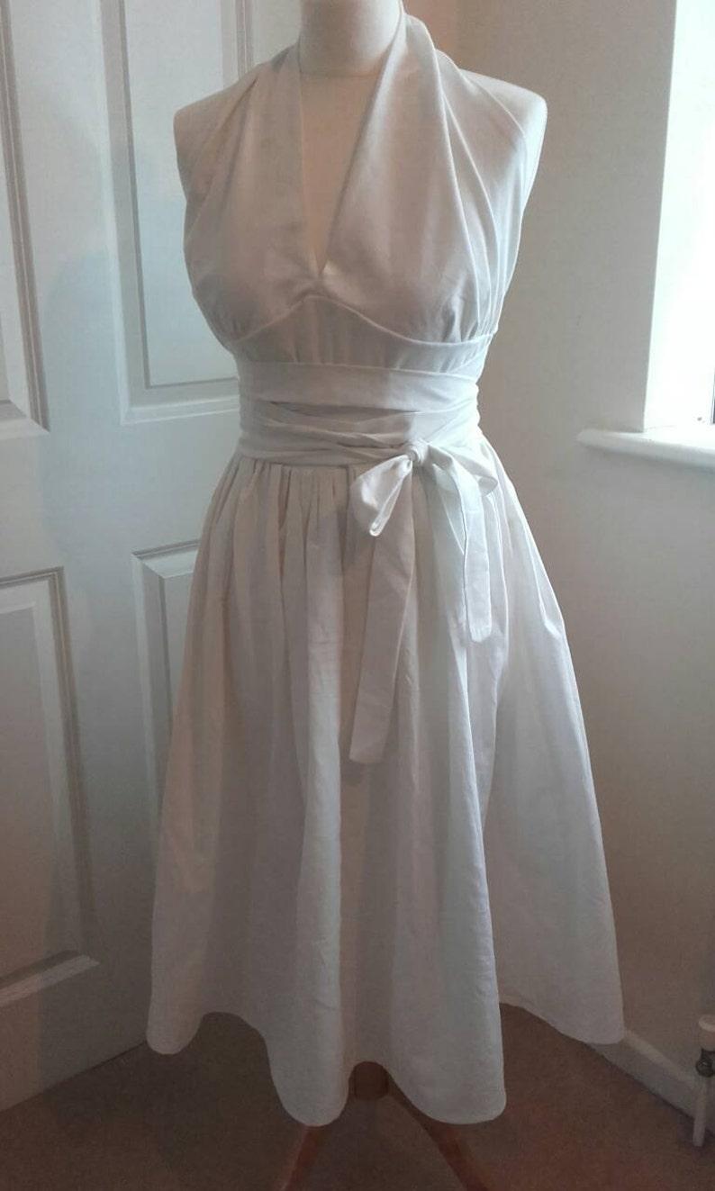 1950s Dresses, 50s Dresses | 1950s Style Dresses Seven Year Itch dress white Halterneck dress 1950s Dress Marilyn Monroe dress sizes 8-22 halloween costume $101.00 AT vintagedancer.com