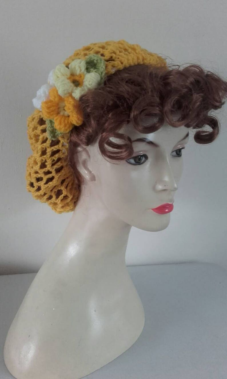1940s Hairstyles- History of Women's Hairstyles Sunshine Yellow Crochet snoodcrochet hairnet 1940s snood snood hairnet hair flowers 1940s hairnet $15.59 AT vintagedancer.com