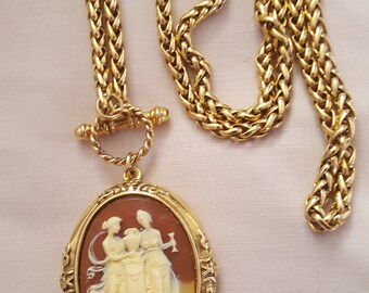 gold coloured cameo locket and chain