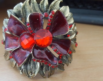 brass bangle with large flower front