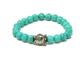 Stretch Bracelet with Beads of Turquoise Howlite Stone and Little Fish