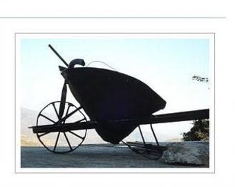 A photograph of an Old Wheel Barrow
