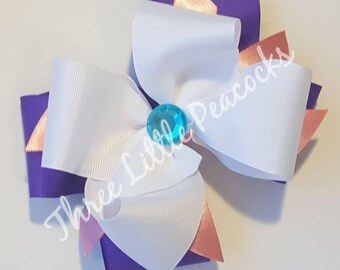 White, purple and pink hair bow