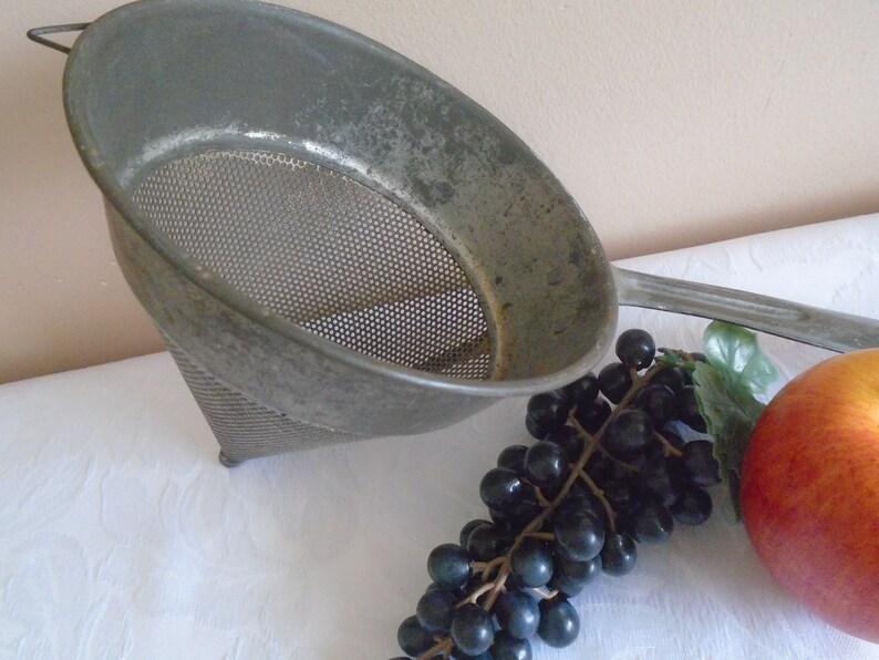 galvanised metal  fruit strainer
