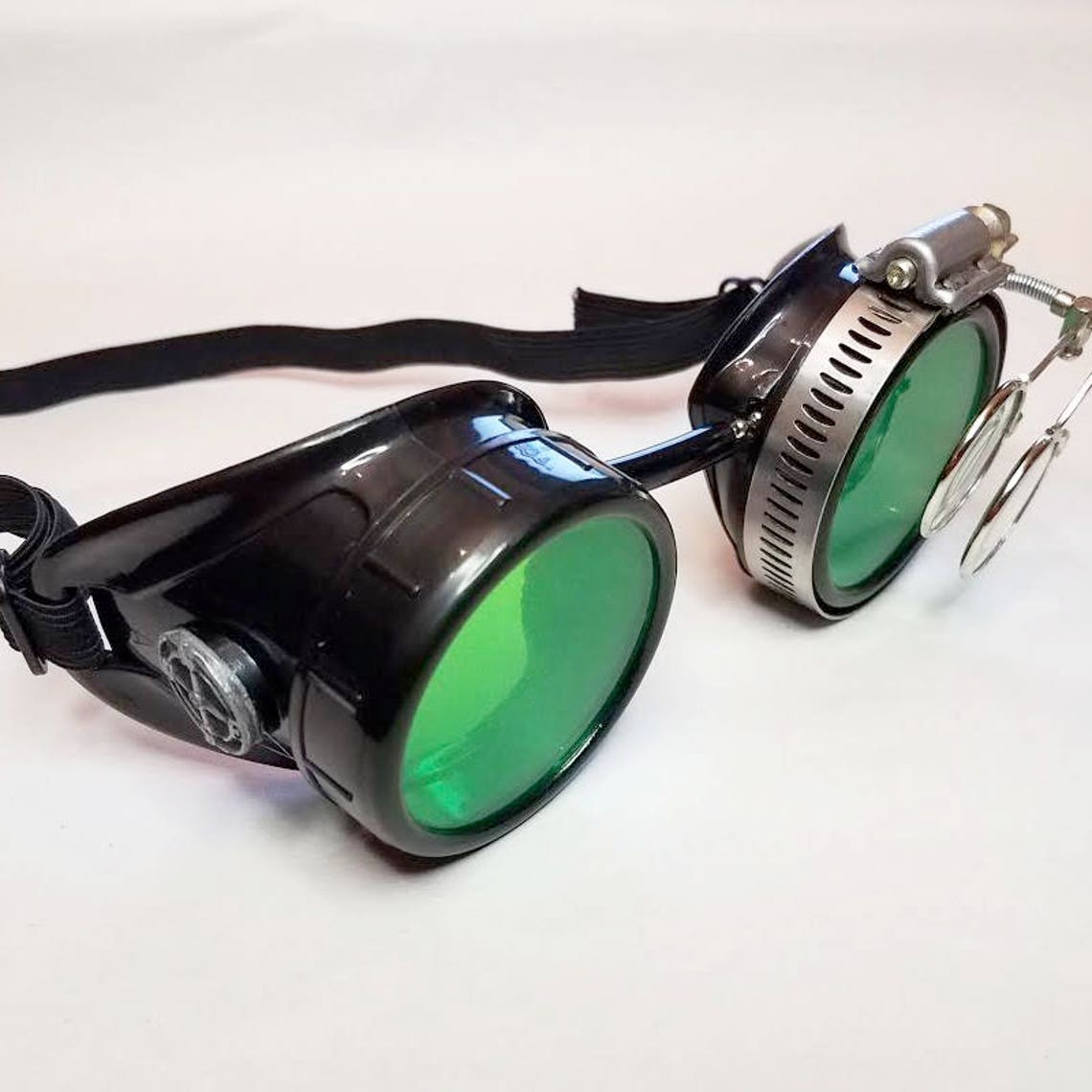 STEAMPUNK GOGGLES, Black with Green Lenses, Silver Compass Rose and Magnifying Loupes, Great for Halloween, Cosplay Costume or Birthday Gift