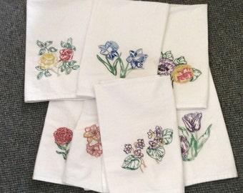 Set of seven cotton tea towels