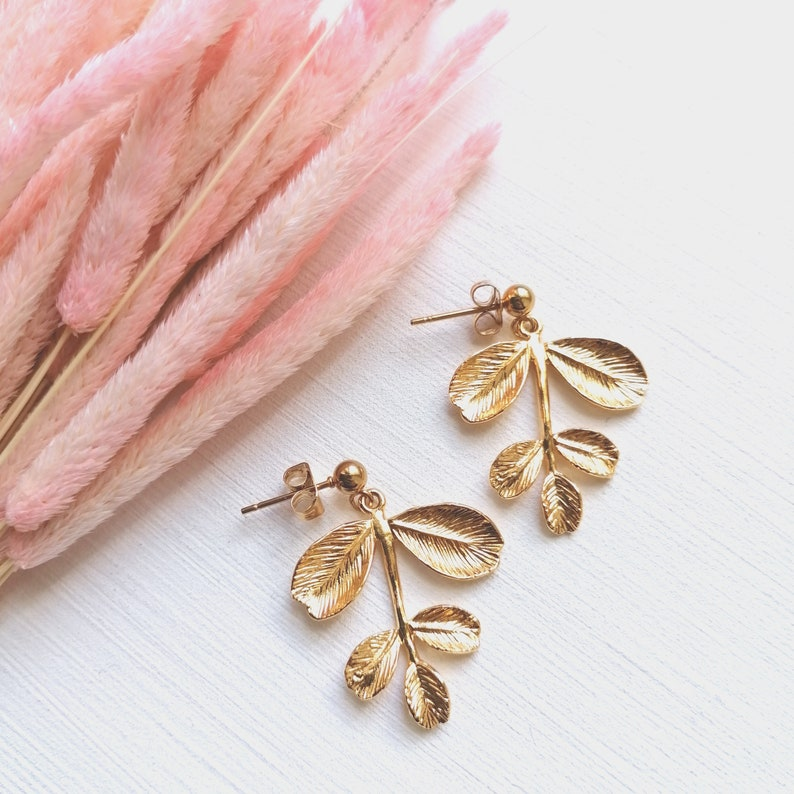 Poetic and delicate gold earrings or dying branches made in image 0