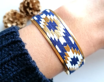 Aztec bohemian chic gold cuff bracelet with white navy blue and gold adjustable waist geometric patterns
