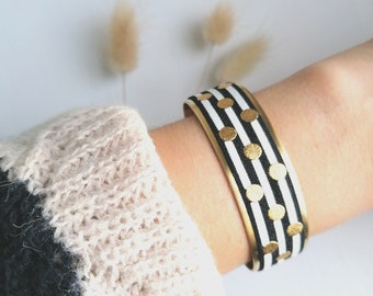 Adjustable gold cuff bracelet in chic seaside style with black and white stripes and trendy golden polka dots