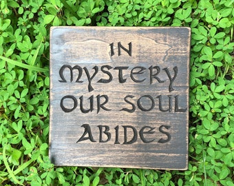 """Hand-carved """"In mystery our soul abides"""" wood sign"""