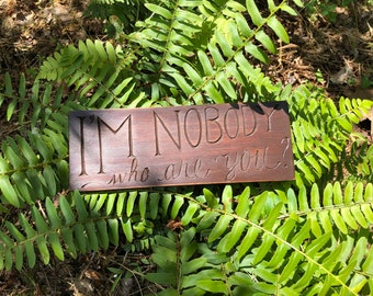 """Hand-carved """"I'm nobody who are you?"""" shelf sign"""