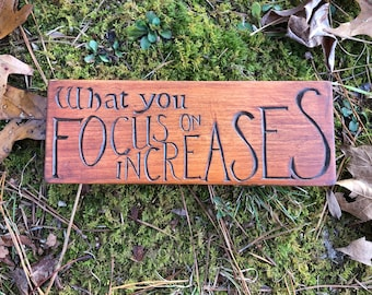"""Hand-carved wood sign: """"What you focus on increases"""" quote; shelf sign, office gift"""