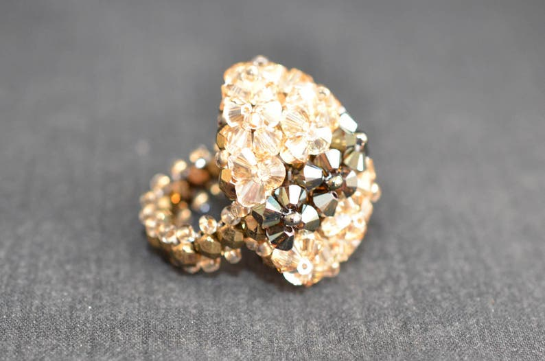 60b809023f78d Swarovski crystal ball ring shade ab2x and crystal golden shadow