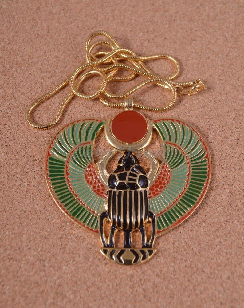 представляет жук скарабей картинки сувениры египет зеленый цены