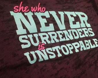 She Who Never Surrenders Is Unstoppable (Black and Pink/Blue)