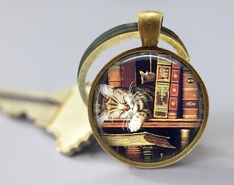 A Sleeping Cat And Old Books Glass Pendant, Photo Glass Necklace, Glass Keychain, Glass Jewelry