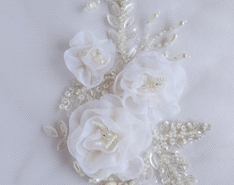 Motif with a bouquet of hand-made organza flowers in ivory and silver