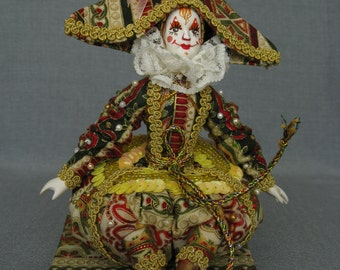 Clown doll handmade with hand painted porcelain face. Named Colored Harlequin. Sitting on wooden chair. Home decoration.Birthay gift.